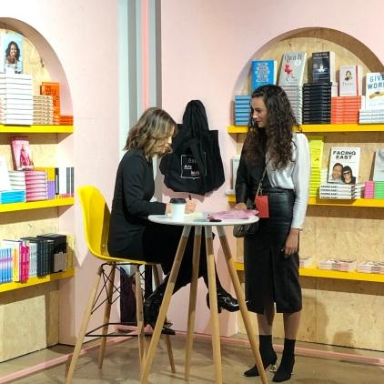 Sophia signing books